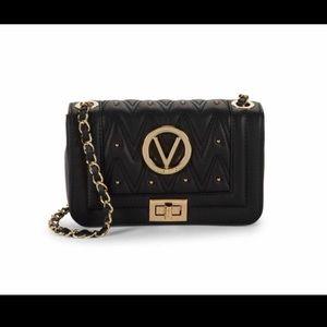 Small Valentino purse.